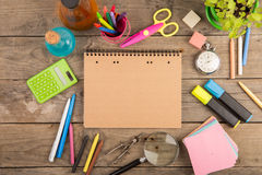Back to school concept - school supplies on the wooden desk. Back to school concept -school supplies on the wooden desk Stock Image