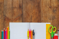 Back to school concept. School supplies on wooden desk Stock Images