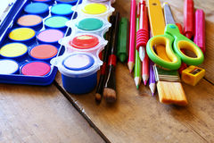 Back to school concept. School supplies on wooden desk Royalty Free Stock Photos