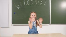 Back to school concept. schoolgirl chalkboard in classroom. Back to school concept. schoolgirl green chalkboard in classroom stock video