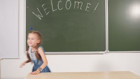 Back to school concept. schoolgirl chalkboard in classroom. Back to school concept. schoolgirl green chalkboard in classroom stock footage