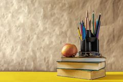 Back to school concept. Stack of books with school supplies stock photography