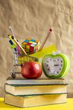 Back to school concept. Stack of books with school supplies in shopping cart royalty free stock image