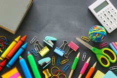 Back to school concept. stationery and book over classroom blackboard. top view, flat lay.  stock images