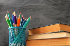 Back to school concept. stationery and books over classroom blackboard.  stock photography