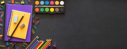 Back to School Concept with Stationery Supplies. And Blackboard royalty free stock images
