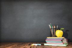 Back to School Concept with Stationery Supplies. And Blackboard royalty free stock photos