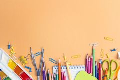 Back to school concept with school supplies and copy space on ye. Llow background. Top view Stock Photography