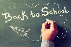 Back to school concept. Teacher writing BACK TO SCHOOL Royalty Free Stock Image