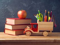 Back to school concept with toy truck and school supplies Stock Image