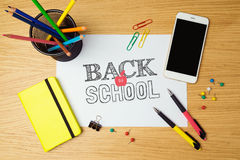 Back to school concept with white paper and school supplies. Royalty Free Stock Images