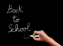 Back to school concept. Woman hand writing on blackboard phrase :back to school, female body part, start of educational season concept Royalty Free Stock Photography