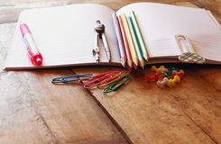 Back to school concept. Writing supplies on wooden desk Royalty Free Stock Photo