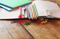 Back to school concept. Writing supplies on wooden desk royalty free stock photos
