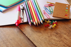 Back to school concept. Writing supplies on wooden desk Royalty Free Stock Image