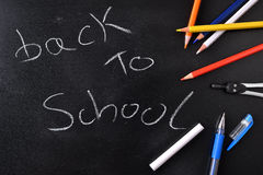 Back to school concept written on a blackboard Royalty Free Stock Images