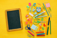Back to school concept on yellow wooden background with empty bl Stock Photo