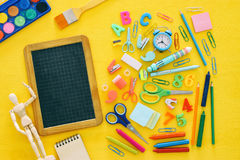 Back to school concept on yellow wooden background with empty bl Stock Image