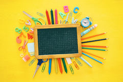 Back to school concept on yellow wooden background with empty bl Stock Photos