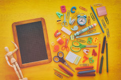 Back to school concept on yellow wooden background with empty bl Royalty Free Stock Images