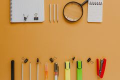 Back to school with copy space concept, in orange color background. Back to school still life concept with orange background Royalty Free Stock Photography