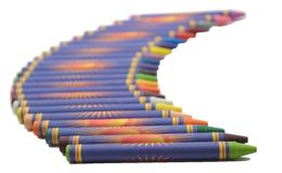 Back to School Crayons. Row of Crayons going blurred towards the background against a white space with a focus to back to school stock photos