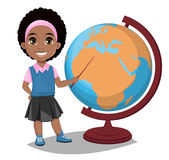 Back to school. Cute Afro-American girl points to the globe with Stock Photography
