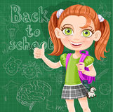 Back to school - cute girl at the blackboard Stock Photography