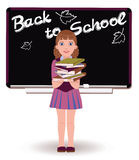 Back to School. Cute little schoolgirl with books Stock Images