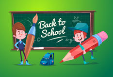 Back to school. Cute schoolchild at a lesson near Royalty Free Stock Photography
