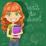 Сute teenager girl at the blackboard Royalty Free Stock Images