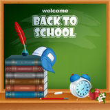 Back to school, design background with primary subject matter, school books and  alarm clock Royalty Free Stock Photos