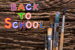 Back to School desk table top view, words on grunge old wooden board background. Education concept. Time for learning. Stock Images