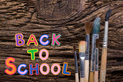 Back to School desk table top view, words on grunge old wooden board background. Education concept. Time for learning. Royalty Free Stock Photography