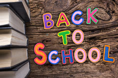 Back to School desk table top view, words on grunge old wooden board background. Education concept. Time for learning. Royalty Free Stock Photo