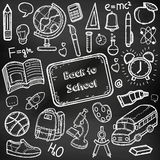 Back to School doodle set. Hand draw school items on a chalkboard. Vector Stock Images
