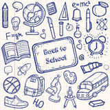 Back to School doodle set. Hand draw school items on a sheet of exercise book. Vector Royalty Free Stock Photo