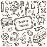 Back to School doodle set. Hand draw school items on a sheet of exercise book. Vector Stock Photography