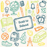 Back to School doodle set. Hand draw school items on a sheet of exercise book. Vector Royalty Free Stock Photography