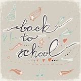 Back to School Doodles with bell, stars,hearts and arrows. Vector illustration. Design Elements. Vector Back to School doodles. Pastel backdrop Royalty Free Stock Photos