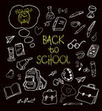 Back to school doodles in chalkboard background Royalty Free Stock Photography