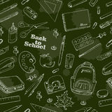 Back to School doodles seamless pattern on a green background Stock Image
