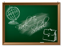Back to school drawing on chalkboard. Hanging on the wall Stock Image