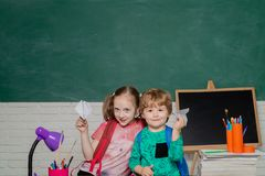 Back to school - education concept. First time to school. Happy cute industrious child is sitting at a desk indoors. royalty free stock photo