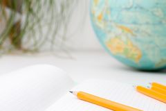 Back to school and education concept. school office supplies pencils, paper, notebook and globe on boke background. for educationa. Back to school and education royalty free stock images