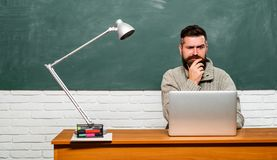 Back to school and Education concept. Student sitting at table and writing on notebook. Back to school. Bearded teacher. Back to school and Education concept royalty free stock image