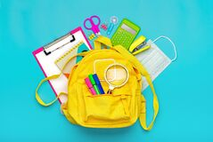 Free Back To School, Education Concept Yellow Backpack With School Supplies, Protective Medical Mask, Calculator, Scissors Isolated On Royalty Free Stock Image - 189796756