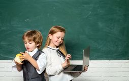 Back to school. Education. Happy smiling pupils drawing at the desk. Boy and girl from elementary school at the school. Yard. Back to school and happy time stock photos