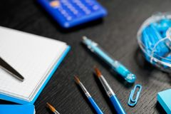 School and office supplies on office table. Male or boyish still life on the topic of school, study, office work. Back to school of education season background stock image