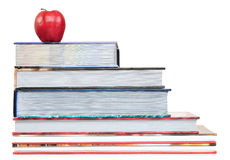Back to school. Educational concept. Red apple on thick books, isolated on white Royalty Free Stock Images
